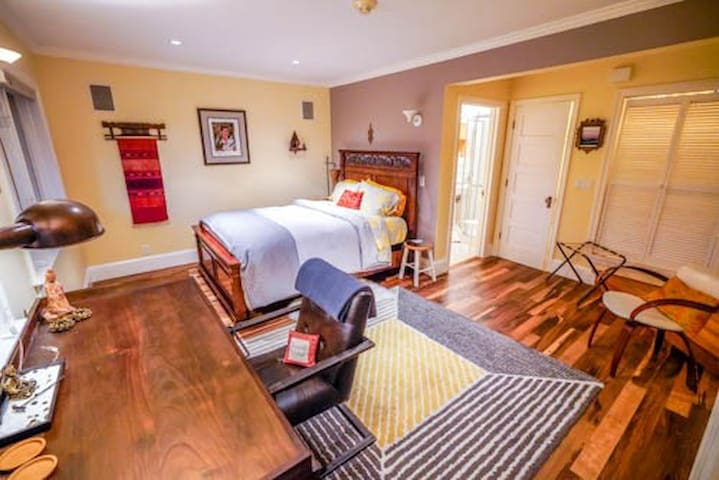 Beautiful and welcoming main bedroom suite just remodeled in 2/2019.  View of gardens when in bed and desk.