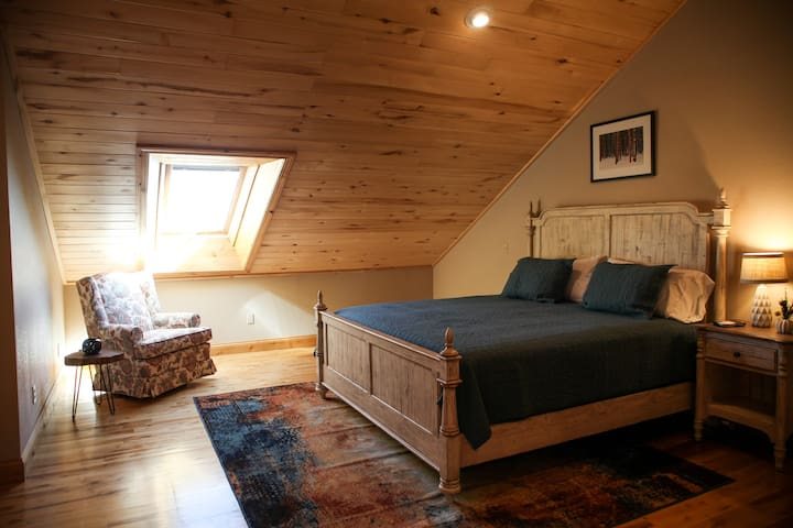 3rd Level Master Bedroom with adjoining full bathroom.  King Size bed, flat screen TV, sky lights and dresser.