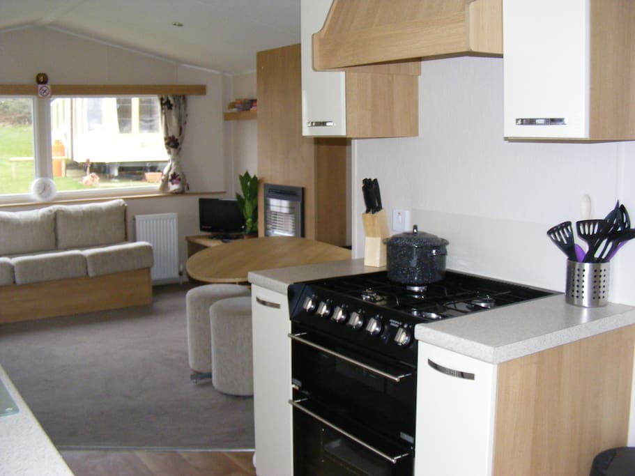 A fully equipped kitchen to cater for upto 8 guests, including cooking utensils, saucepans, baking trays,  crockery and cutlery etc..  Gas oven, fridge with ice-box, microwave, kettle & toaster