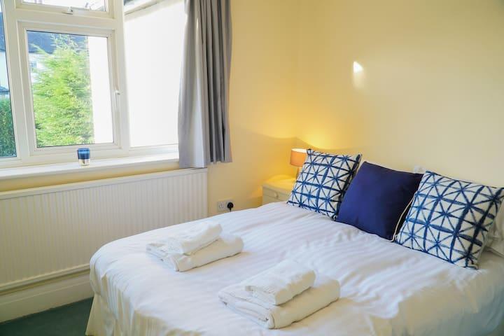 Bedroom 2 - Double bedroom with extensive built-in wardrobes