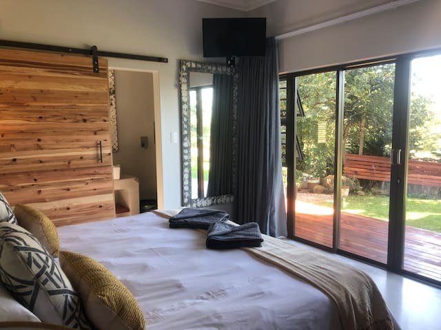 Enjoy views from the bedroom of our garden, pool or ocean