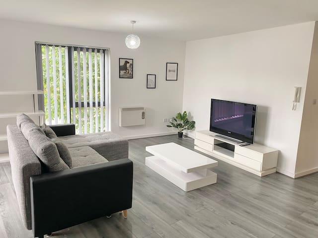 "Open plan living room with 43"" Smart TV"