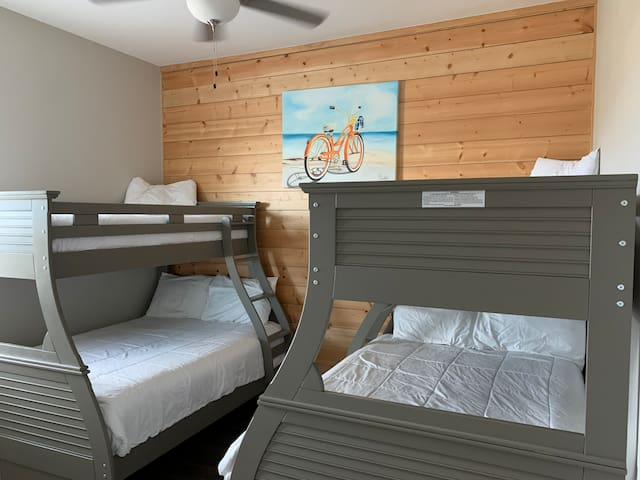 """Bedroom #4 is perfect for the children, it has two full beds and two twin sized beds. It has its own 50"""" tv. And a roomy closet. This room is located in the third floor."""