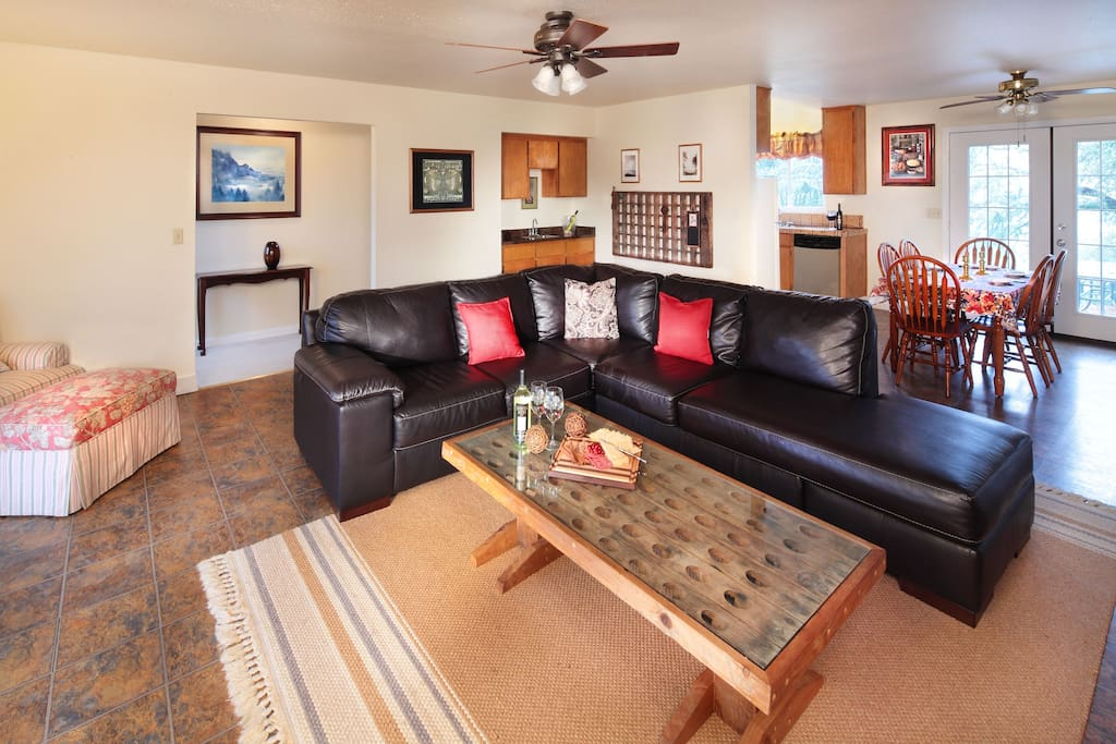 Comfortable living room with full kitchen and wet bar.
