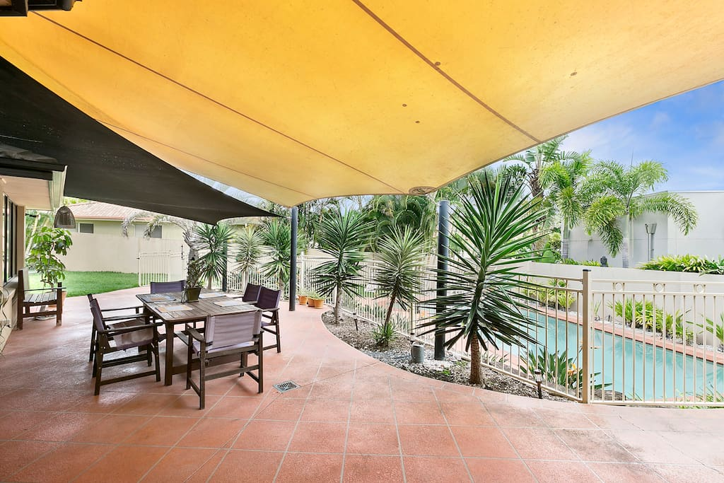 Outdoor under cover area overlooking swimming pool