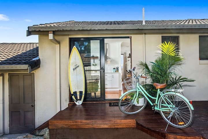 Entry deck with palm theme. Go for a surf or take a ride into town