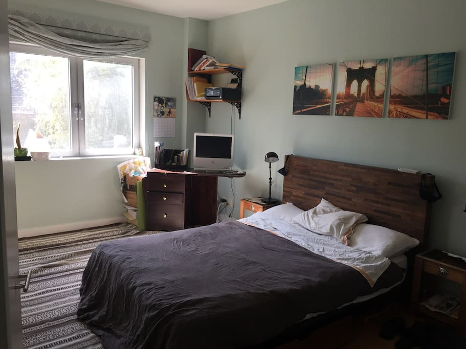 Master bedroom with adjoining bathroom.  Plenty of space and light with a lovely view of the downstairs garden.