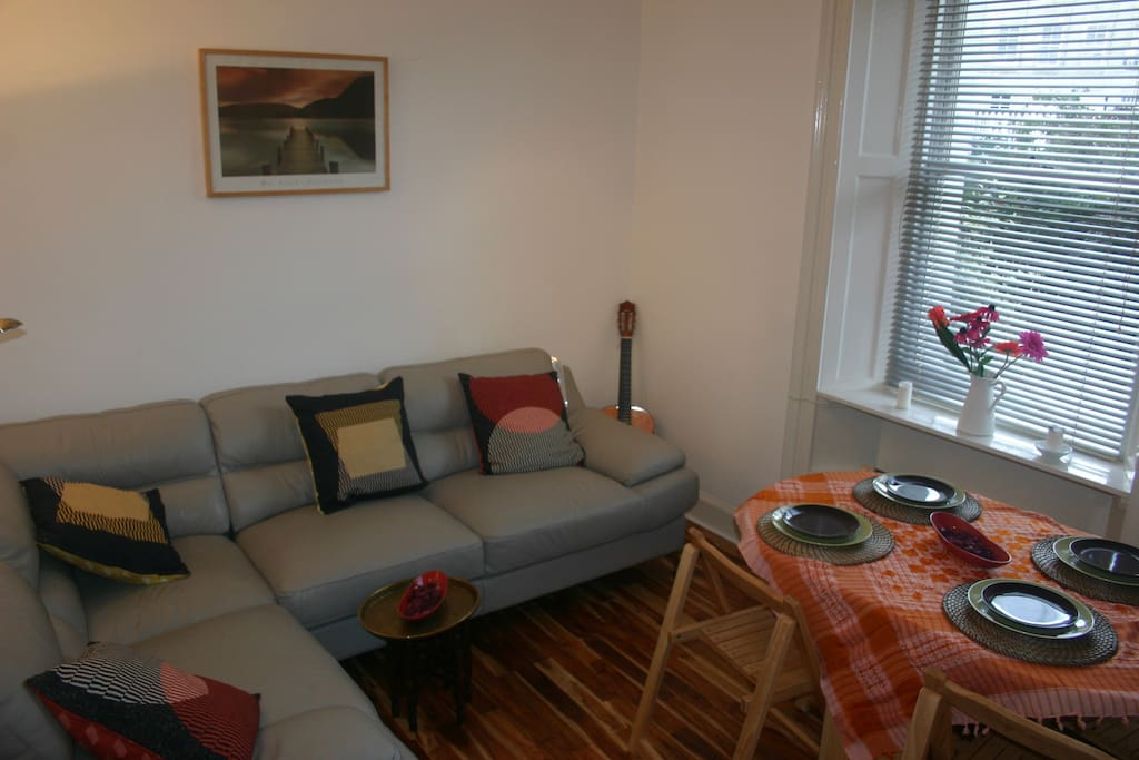 The lounge with comfortable corner sofa for 4 and dining table for 4