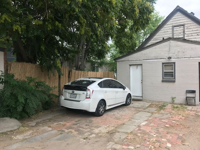 This photo shows the ONE parking spot that is available to guests in the back of the house. The side yard gives access to the front door. There is another dog who shares the yard. If you do not like dogs this property is not a good fit for you.
