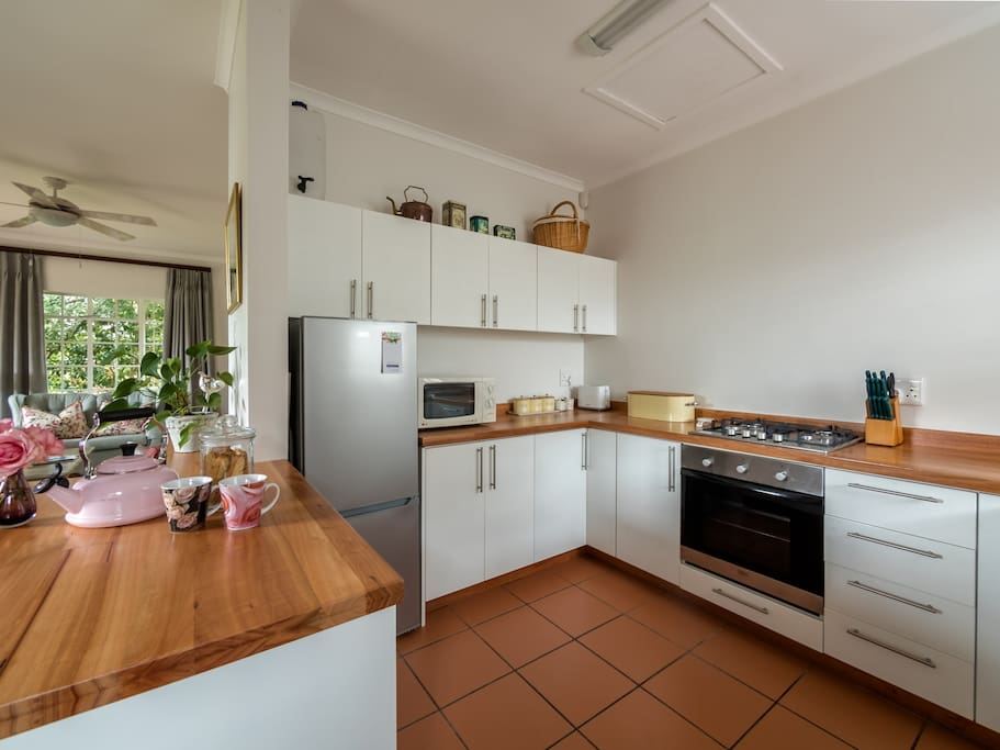 New modern kitchen with all the mod-cons including microwave, oven and hob, fridge/freezer.  Perfectly set up with everything you need to prepare meals.