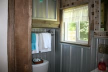 Bathroom, off the Main bedroom, with stand-up shower featuring industrial taps and rustic styling with all the comforts you need.  Nice linens, quality fixtures, all the conveniences.