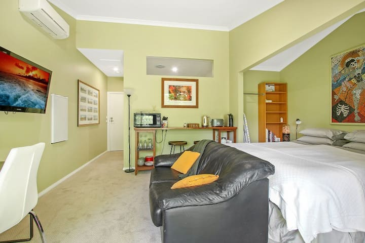 Maple Garden Studio comprises King (split) bed, modern bathroom,  leather couch, TV,  kitchenette with microwave, coffee machine, kettle & toaster, bar fridge & split system air-conditioning & heating.