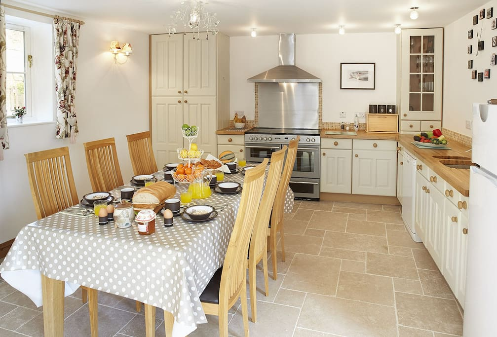 Ground floor: open plan kitchen/dining/sitting area which seats eight for dining and six in separate relaxation area