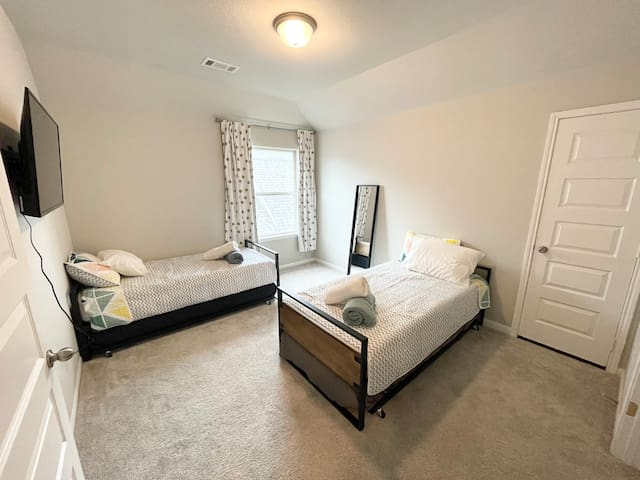 Bedroom with (2) twin beds & (2) twin trundles.
