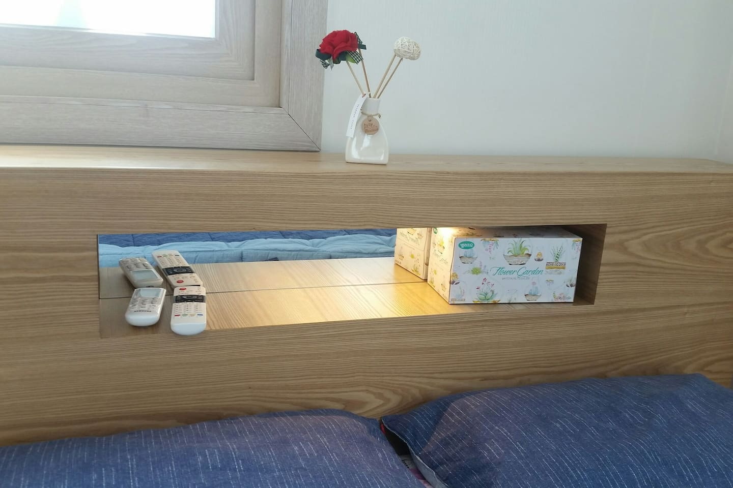 A Queen bed with LED light and mirror.