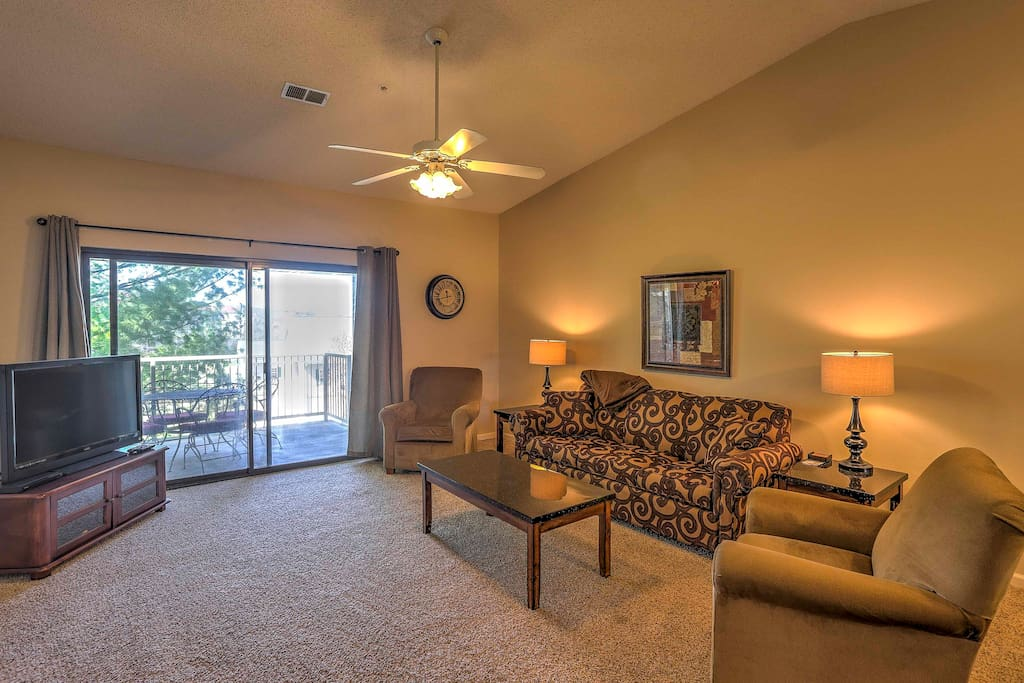 Relax in the living room as you watch a show on the flat screen cable TV.