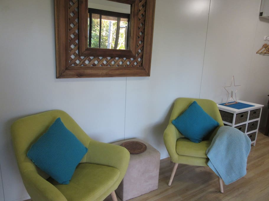 Comfy chairs to look out towards the pool, read a book or watch TV