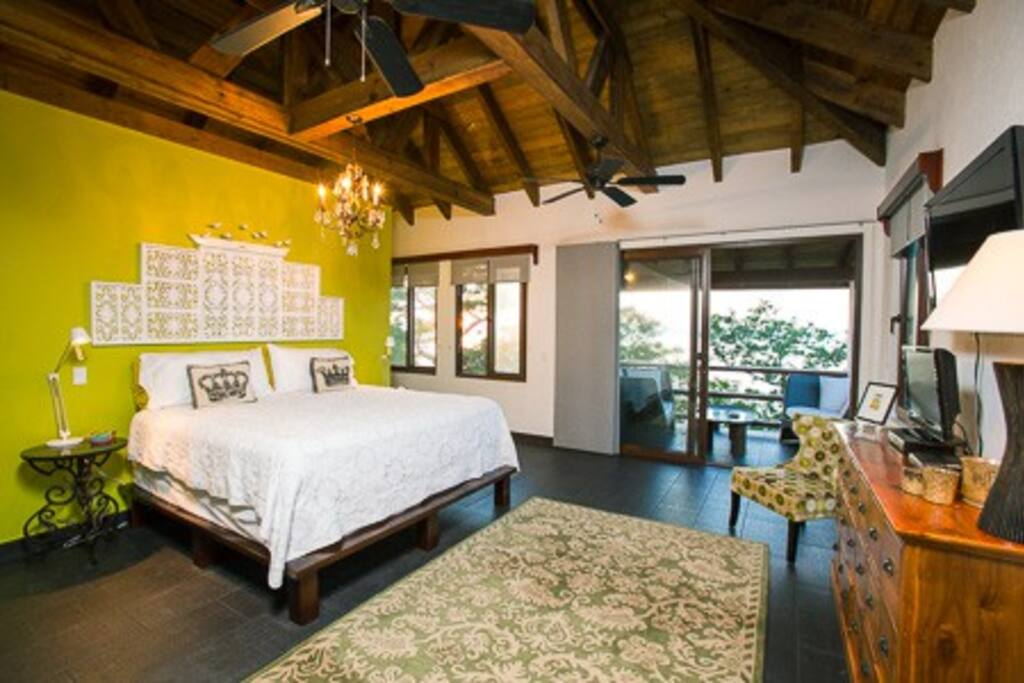 Master bedroom #1 with en suite bath and porch affording a  breathtaking sea and reef view.