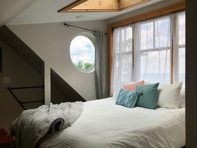 """We used to call it """"The boathouse"""" for this little porthole window. Our little joke since we're nowhere near water :D"""