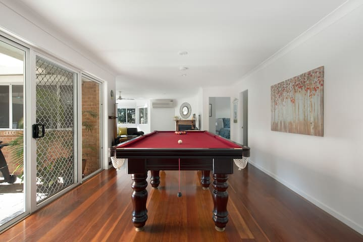 Our 8-foot slate pool table is great fun. Who will pot the black?