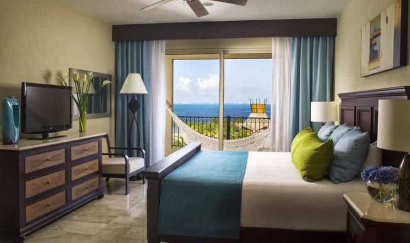 Master Bedroom has it's own full en-suite bathroom and deck with hammock