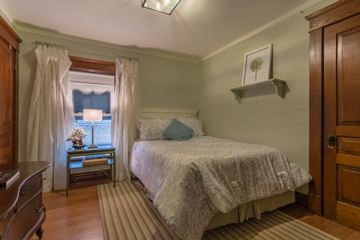 This double bed is the middle bedroom. Each has closet/hanging space for you to use.
