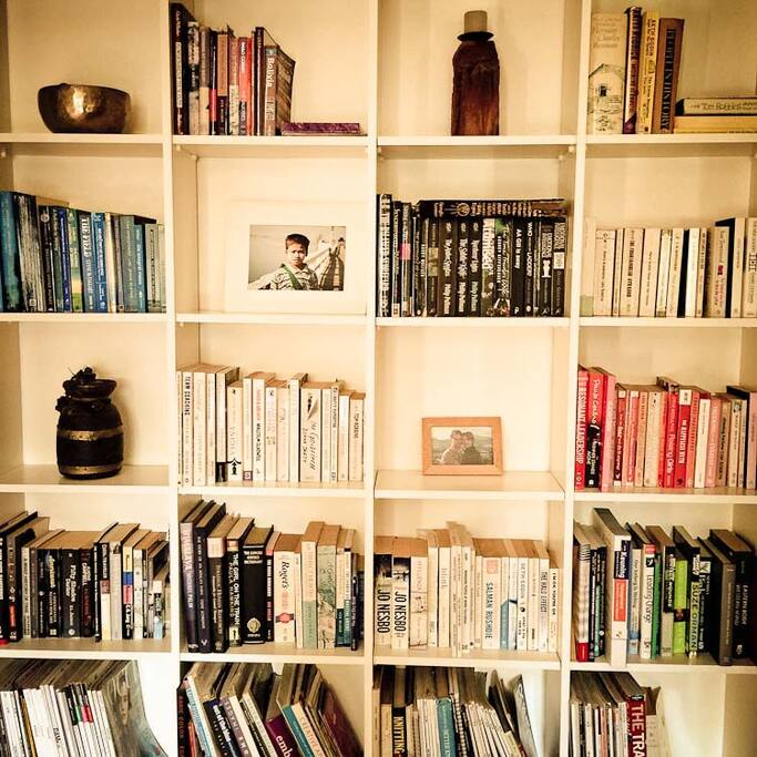 Bookshelves in your room with plenty of books to read
