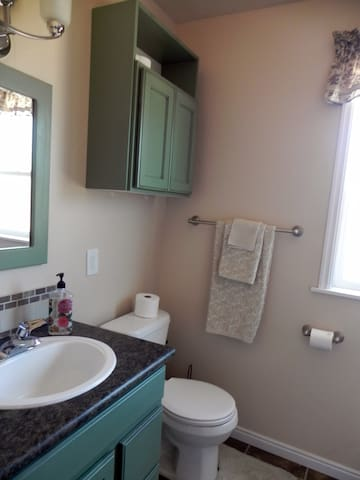 Everything in the bathroom is new:  new tile , new fixtures, new floor.  Even the towels and rugs are new.