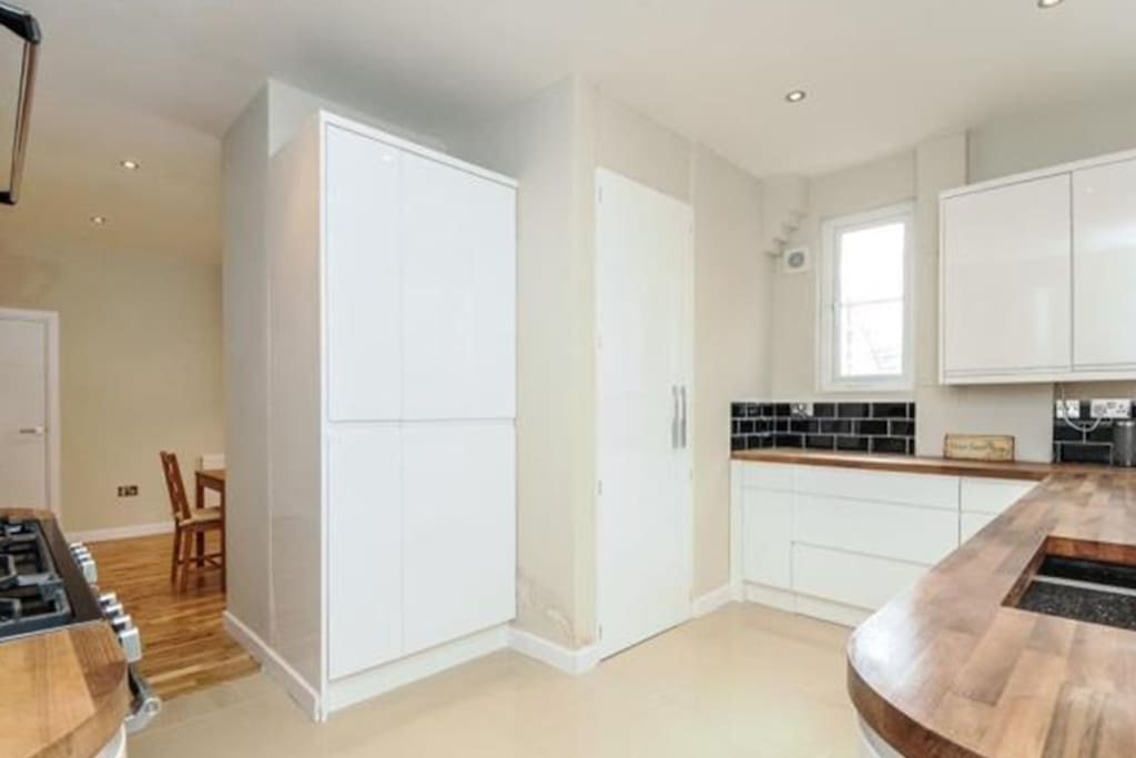 Generous kitchen space with access to all laundry facilities and appliances