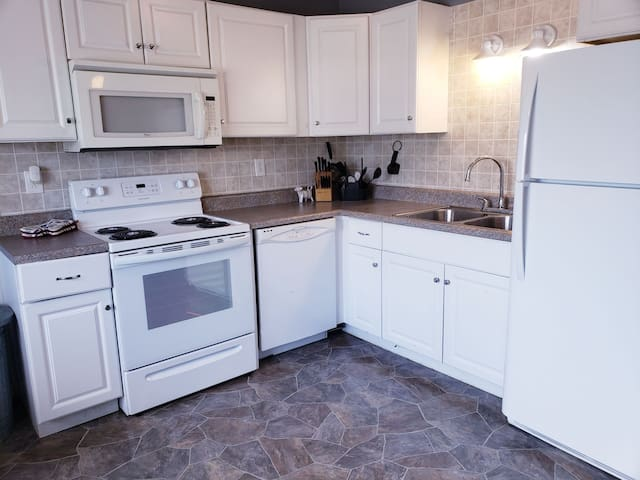 Cozy little kitchen area with new appliances