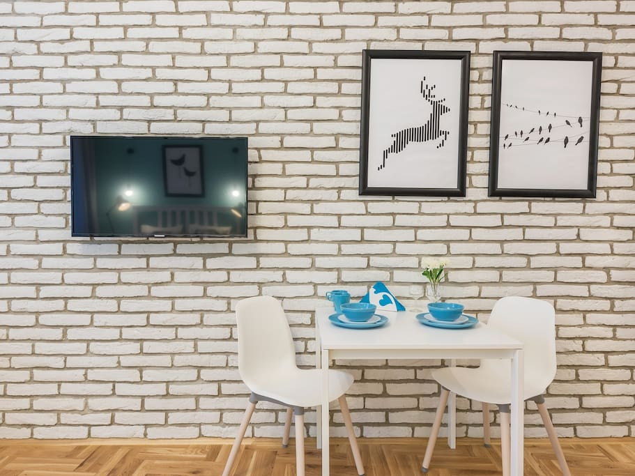 dining area, table, tv set