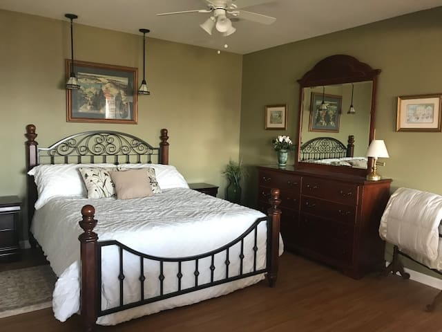 Bedroom with large closet and dresser.   Extra blankets and linens for sleep sofa