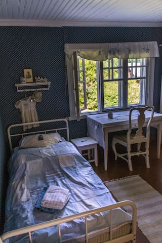 THEBlue room - one of the two bedrooms included in the booking. This room has one single bed.