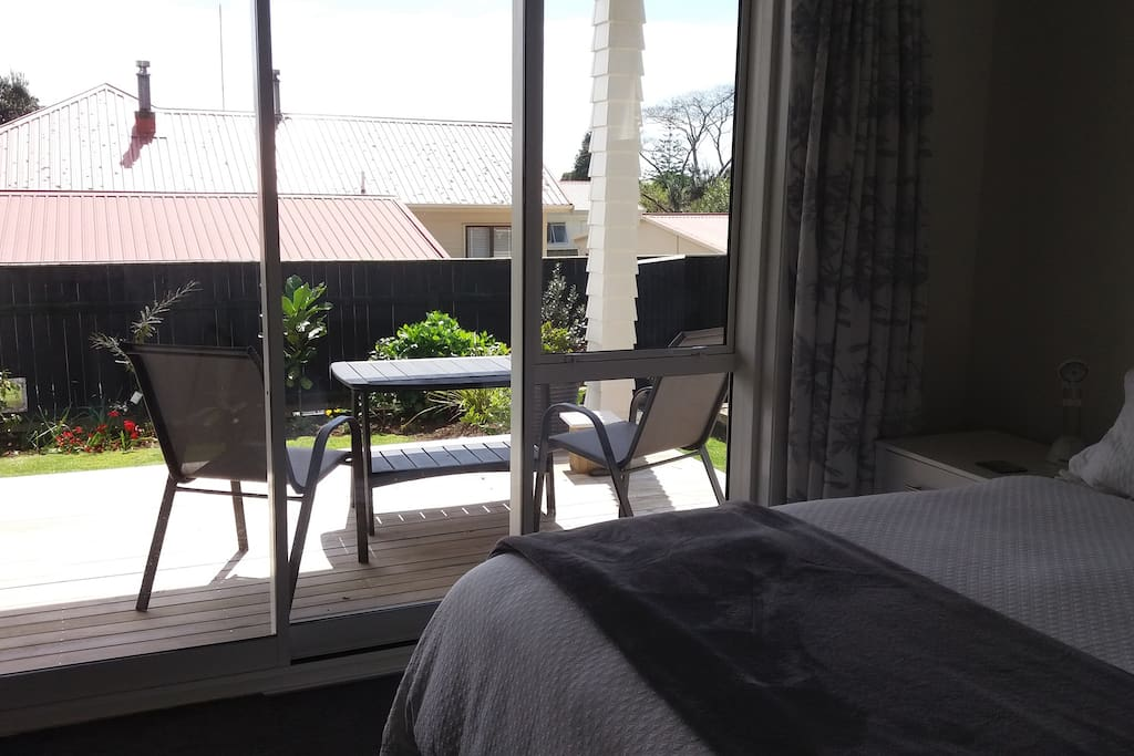 Light, airy bedroom opens onto sunny, north facing deck