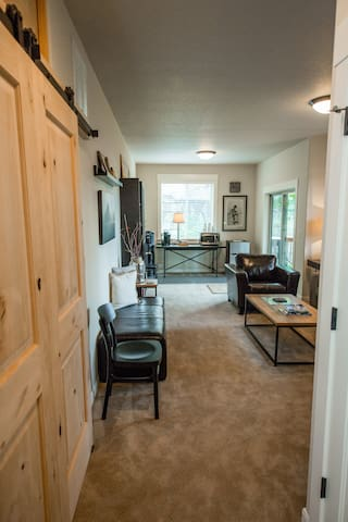 Privacy locked knotty alder barn doors add warmth and character