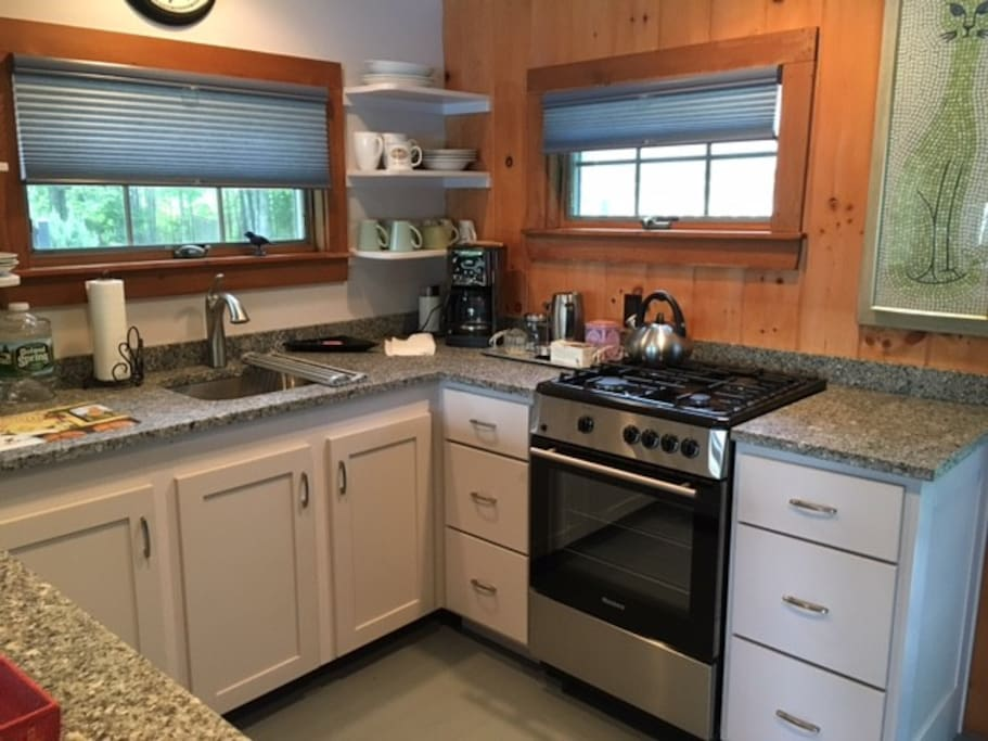 kitchen with granite counter tops and gas range
