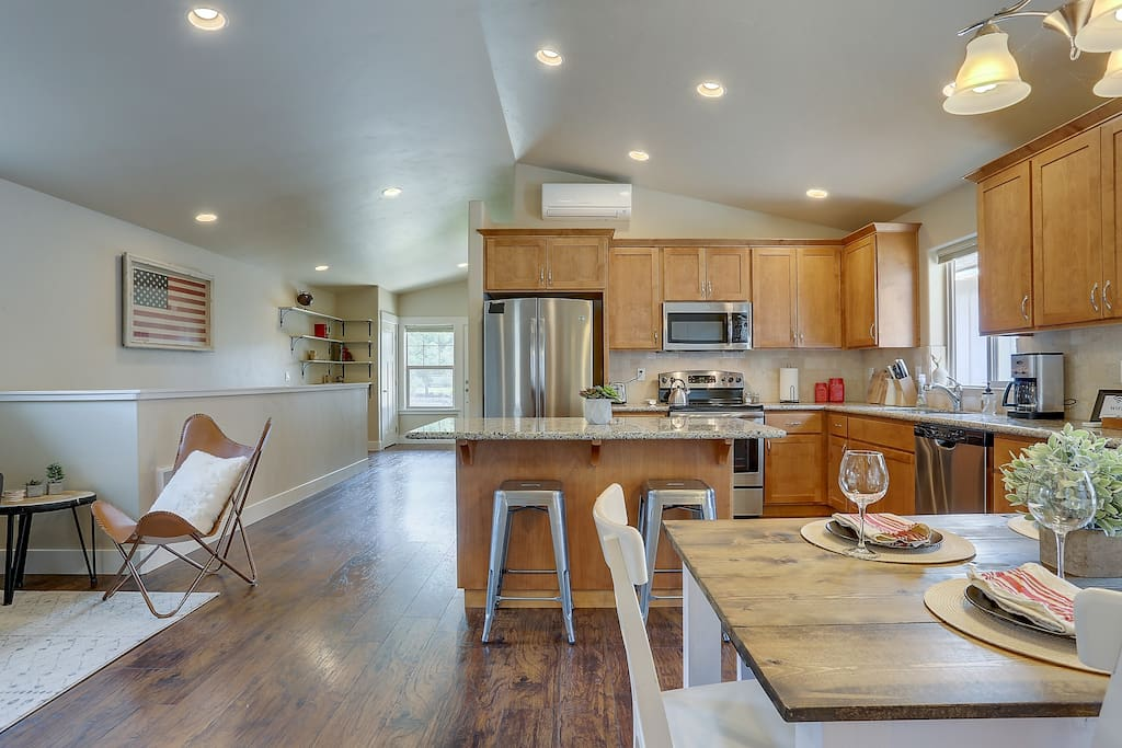 Full kitchen amenities; coffee maker, full range, dish washer. Tons of plates, cups, bowls, utensils, pans, and every cooking accessory you could imagine. Including coffee!