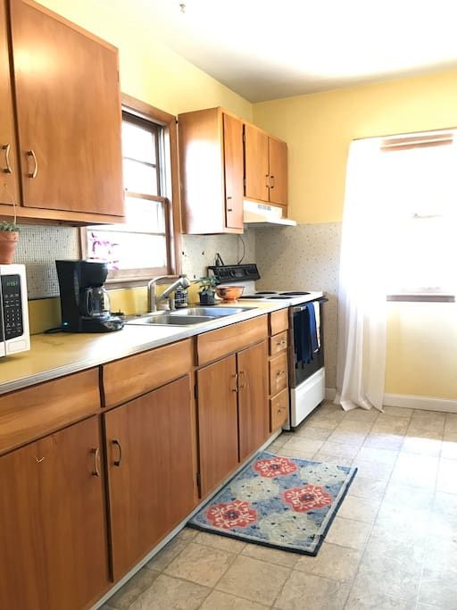 Wake up to the sunny yellow kitchen; plenty of tea and coffee to go around!
