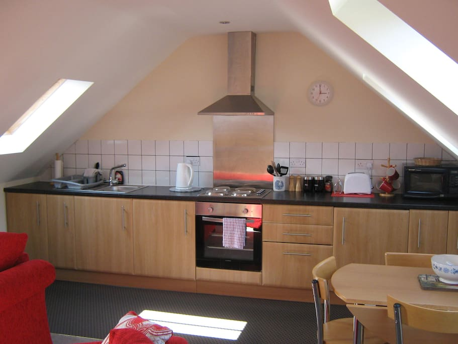 Fully fitted kitchen with built under oven / hob / fridge freezer / microwave.