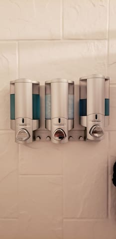 This Soap, Shampoo and conditioner dispenser is located on the back wall of the shower for your convenience.