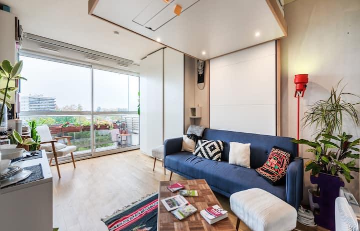 Modern studio with home-cinema and balcony