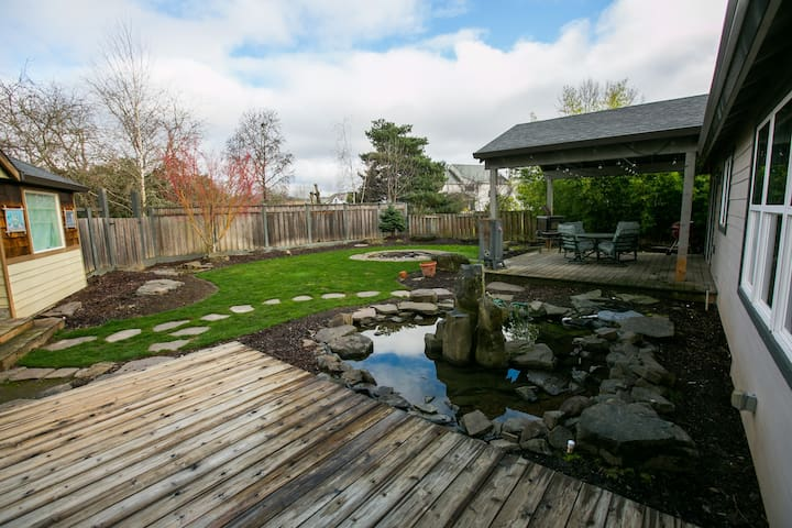 Beautiful backyard with firepit and fenced yard