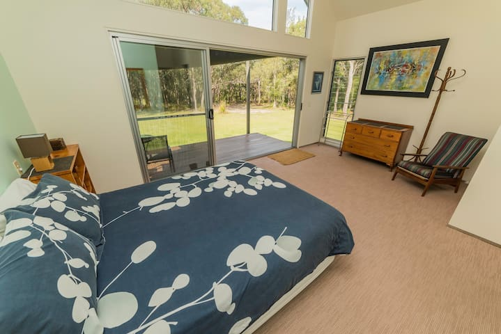 Main bedroom with queen bed, ensuite and private deck area.