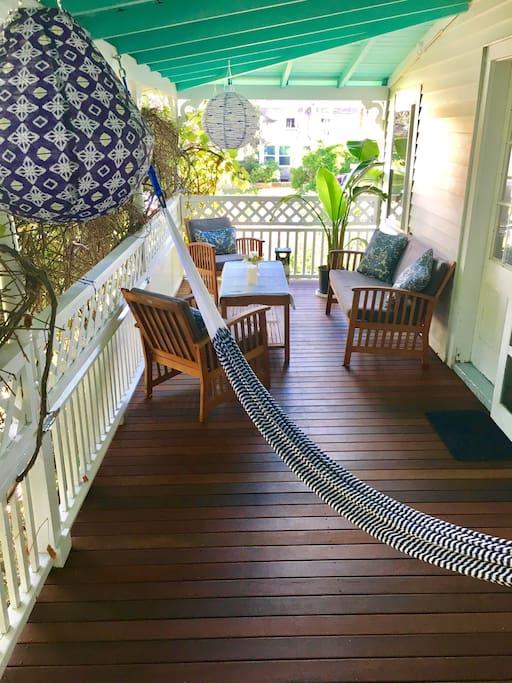 2nd floor private deck with hammock, lanterns, and teak furniture, off master bedroom.