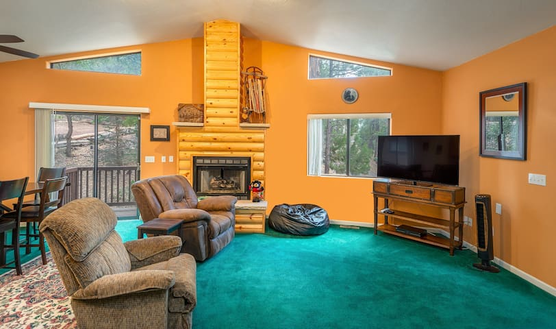 A cozy living room provides the perfect spot to relax at the end of a day of outdoor adventure!