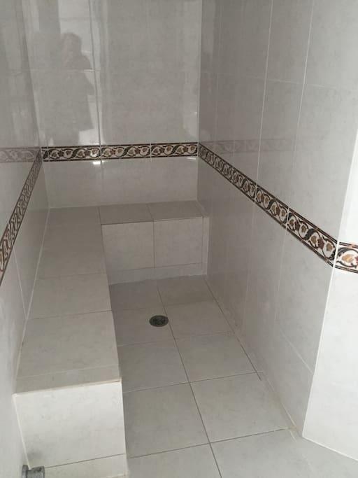 Steam room in master bedroom bathroom