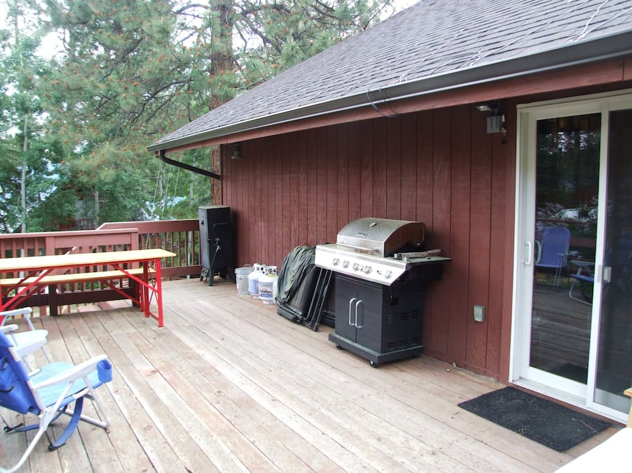 Deck with propane bbq, table, & chairs
