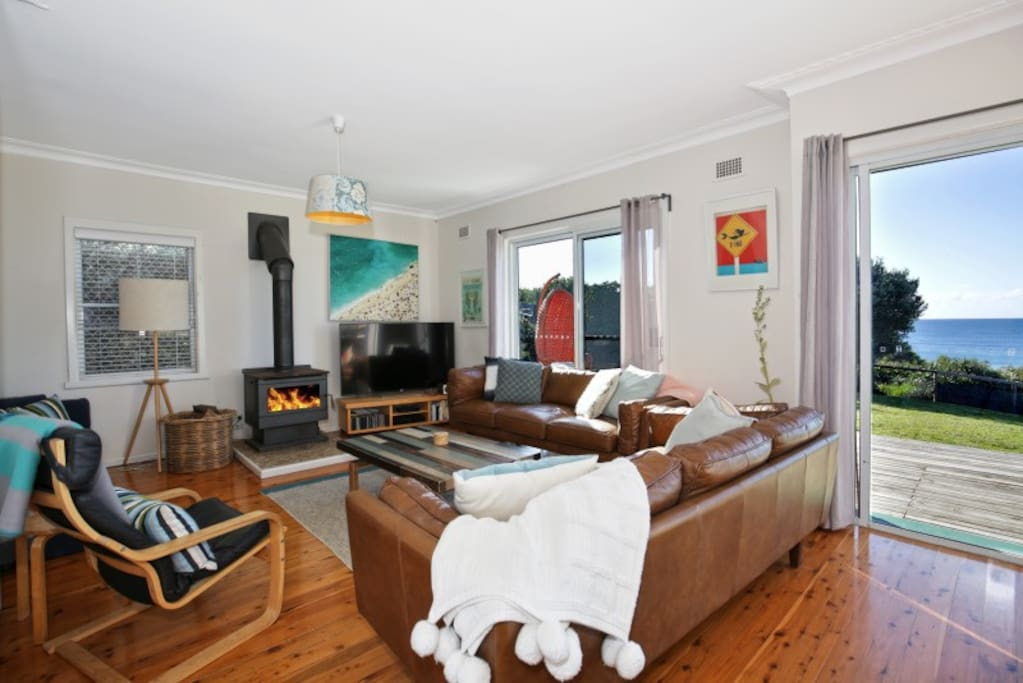 Living room with foxtel wood fire, large TV and wi-fi