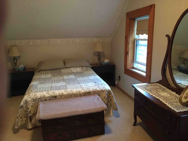 The front bedroom offers comfortable accommodation for two