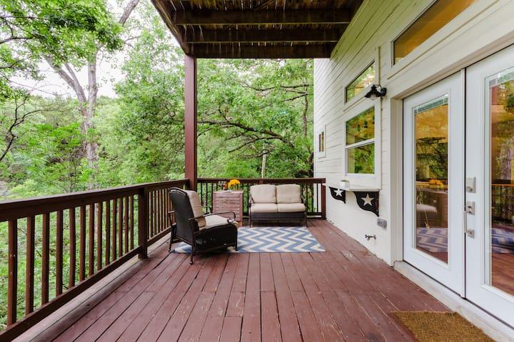 Private balcony overlooking greenbelt.